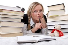 Schoolgirl or student reading books. Interesting books. She is happy. On white Stock Photos