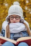 schoolgirl student reads study book outdoors royalty free stock photo