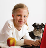 Schoolgirl studies at home on a laptop Royalty Free Stock Images
