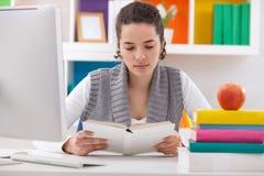 Schoolgirl study at home Stock Photos