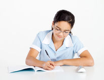 Schoolgirl studying Royalty Free Stock Images