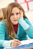 Schoolgirl Studying In Classroom Royalty Free Stock Photo