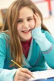 Schoolgirl Studying In Classroom Stock Image