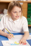 Schoolgirl Studying In Classroom Stock Photography