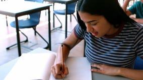 Schoolgirl studying in classroom. At school stock video footage