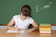 Schoolgirl studying at the classroom. Schoolgirl studying science  at the classroom Royalty Free Stock Photo