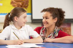 Schoolgirl Studying In Classroom With Teacher Stock Photography