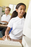 Schoolgirl studying in front of a school computer Royalty Free Stock Images