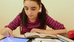 Schoolgirl studying using tablet pc stock video footage