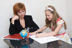 The schoolgirl with teacher Stock Photography