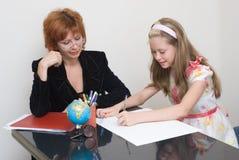 The schoolgirl with teacher Stock Photography