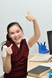 Schoolgirl teen girl rejoices a good estimation. Homework done and in a good mood Royalty Free Stock Photo