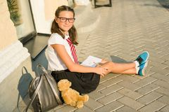 Schoolgirl teenager writes in a notebook. Diary girls, secrets,. First love Royalty Free Stock Images