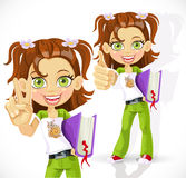 Schoolgirl with a textbook making victory sign Royalty Free Stock Images