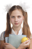 Schoolgirl  with textbooks and apple. Royalty Free Stock Photography