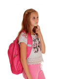 Schoolgirl thinking with backpack. Royalty Free Stock Photography