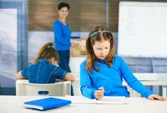 Schoolgirl writing test Royalty Free Stock Images