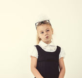 Schoolgirl thinking, funny face Stock Photo