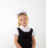 Schoolgirl thinking, funny face Royalty Free Stock Image
