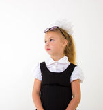 Schoolgirl thinking, funny face Stock Image