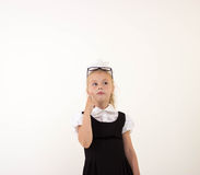 Schoolgirl thinking Royalty Free Stock Images