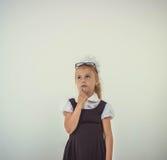 Schoolgirl thinking Royalty Free Stock Image