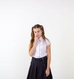 Schoolgirl thinking Stock Photos
