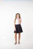 Schoolgirl thinking Stock Images