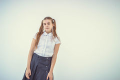 Schoolgirl thinking Royalty Free Stock Photo
