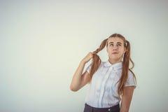 Schoolgirl thinking Royalty Free Stock Photography