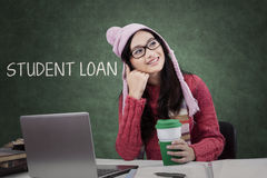 Schoolgirl thinking about student loan Stock Photography