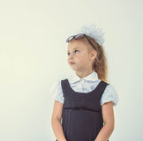 Schoolgirl thinking in uniform, funny face Stock Photos