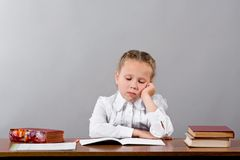 Schoolgirl thinks over the difficult task Royalty Free Stock Images