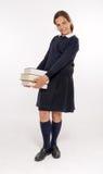 Schoolgirl with three heavy volumes Stock Photos