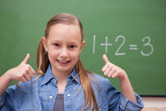 Schoolgirl with the thumbs up Stock Images