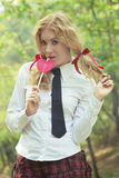 Schoolgirl in tie with lollipop Stock Photo