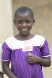 Happy Schoolgirl in Uganda with school uniform Royalty Free Stock Images