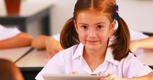 Schoolgirl using digital tablet in classroom. Portrait of schoolgirl using digital tablet in classroom at school 4k stock video