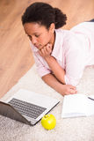 Schoolgirl using laptop Royalty Free Stock Photography