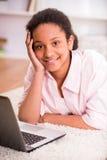 Schoolgirl using laptop Stock Photo