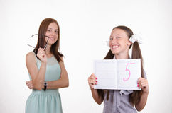 Schoolgirl very happy received five Royalty Free Stock Photos