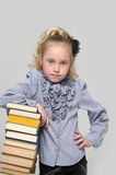 Schoolgirl with a very high stack of books Royalty Free Stock Photo