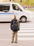Schoolgirl waiting for the traffic light Royalty Free Stock Photo