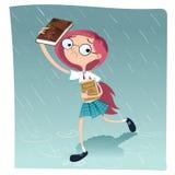 Schoolgirl walking in the rain. Stock Photo