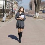 Schoolgirl walking on spring sunny street Royalty Free Stock Photography