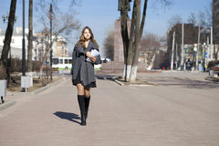 Schoolgirl walking on spring sunny street Royalty Free Stock Image