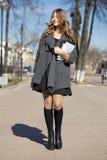 Schoolgirl walking on spring sunny street Stock Image