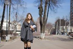 Schoolgirl walking on spring sunny street Stock Photos