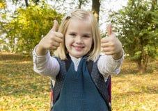 Schoolgirl walks in the park Stock Photos