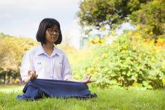 Schoolgirl was meditating. Stock Photography
